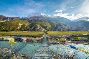 Nepal - suspension bridge with buddhist prayer flags
